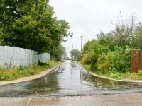 Заасфальтированная боковая улица - сентябрь 2013