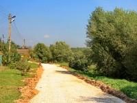 Август 2013 - в Редькино идет работа по укладке щебня