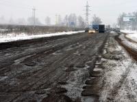 Разбитая дорога у Еганово на Володарском шоссе  - декабрь 2013