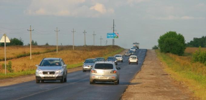 Svezhij-asfalt-na-Volodarskom-shosse-avgust-2014
