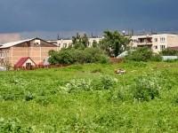 Вид с площадки на школу и многоэтажки села Константиново